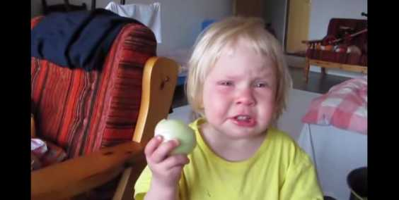Little Girl Can't Stop Herself From Eating Raw Onion. That ...