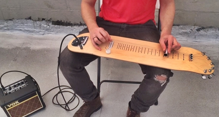 Incredible: Guy Plays Music Using A Lap Skate Guitar – You've Never Seen Like This Before
